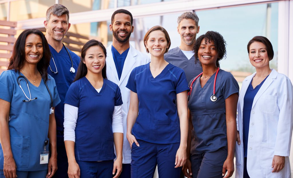 Group shot of doctors and nurses represent GPRO, a Group Practice Reporting Option.
