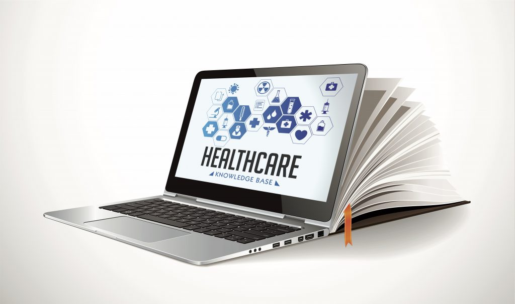 Open laptop shows Healthcare Study Design on screen.